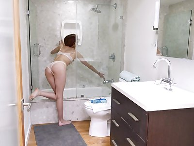 After she takes a shower Andi Rye masturbates in the bathroom