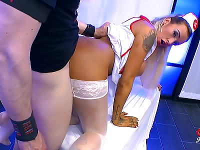 Nasty nurse taking cock and cumshots in a group scene