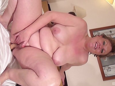 Fat of age with big saggy tits pleasuring herself with a dildo