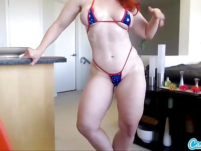 Andrea Rosu muscled pornstar redhead babe shakes her booty and oils up her big tits in webcam solo